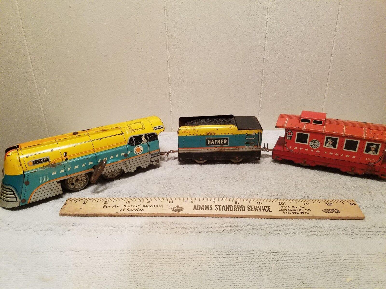 Vintage Hafner Clockwork Wind Up Tin Train Set con 10 piezas de pista