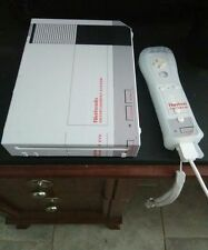 pre owned soft modded Nintendo WII w/16gb SD card.