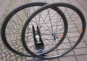 Campagnolo-Hyperon-Carbon-Wheels-Tubular-28-034-700-roues-helices-Gaines-record-CONTINENTAL
