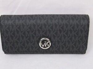 a4057ae495b2 NWT Michael Kors PVC MK Signature Fulton Flap Continental Carryall ...