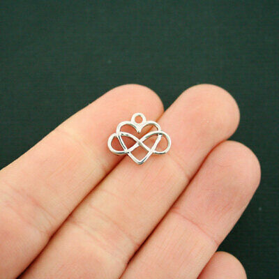 4 Celtic knot heart charms silver tone R154