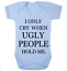 Novelty /'I only cry when ugly people hold me/' Blue bodysuit//vest