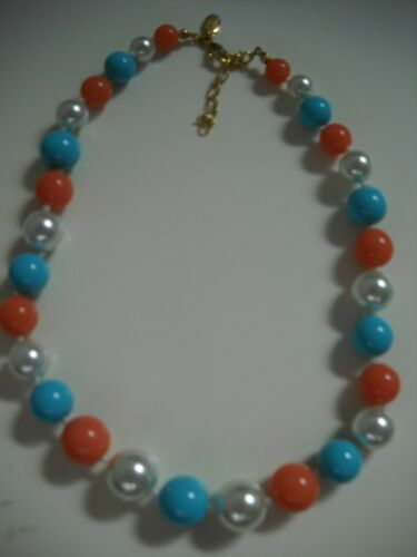 Nolan Miller Faux Coral and Gold Seed Bead Torsade with Rhinestone Accented Focal Slag Bead