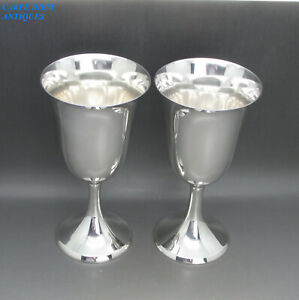 LUXURY QUALITY PAIR SOLID STERLING SILVER WINE GOBLETS BY CARTIER. 17CM HIGH.