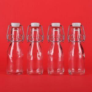 12 leere Glasflaschen 100 ml  mit Bügelverschlus<wbr/>s kleine Bügel-Flasche 0,1 liter