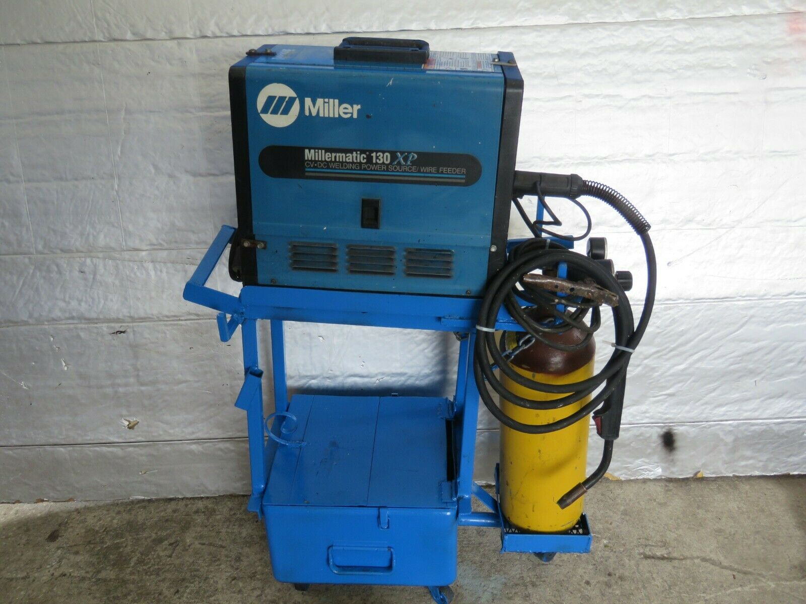Miller Millermatic 130 MIG Welder With Stand, Gun, Spool and Accessories. Available Now for 999.99