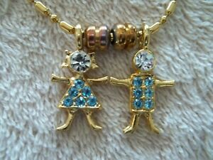 Signed-034-K-I-S-USA-034-Necklace-Pendant-Gold-Tone-Metal-Boy-amp-Girl-Charms