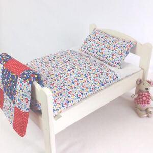 DOLLS-BED-PRAM-COT-BEDDING-SET-GARDEN-FLOWERS-BABY-ANNABELL