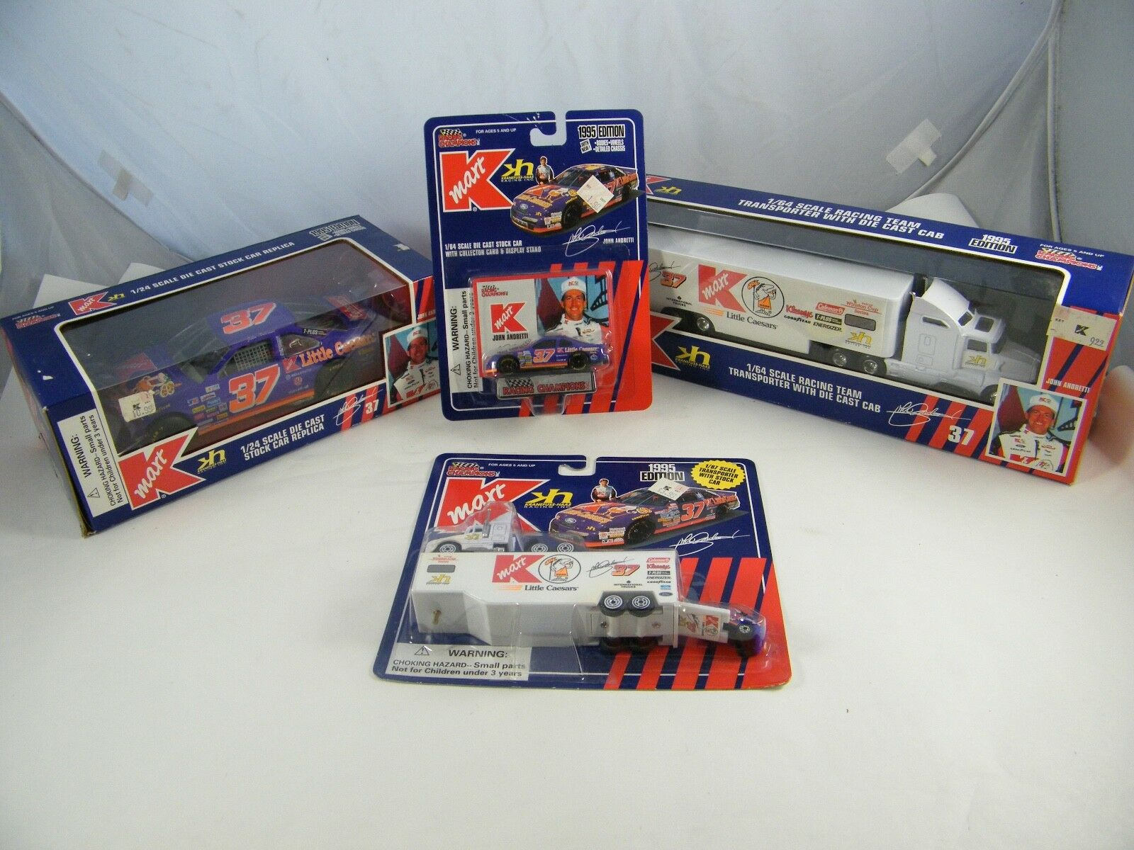 1995 RACING CHAMPIONS KMART JOHN ANDRETTI TRANSPORTERS AND CARS