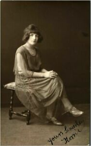 Portrait pretty young lady RPPC postcard antique photograph signed oak stool