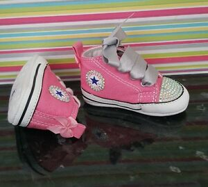 fd99540d7f89 Image is loading Girls-pink-customised-Converse-trainers-bling-toes-size-