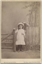 CABINET CARD SMALL GIRL STANDING WITH FENCE HOLDING AN UMBRELLA IN A WHITE DRESS