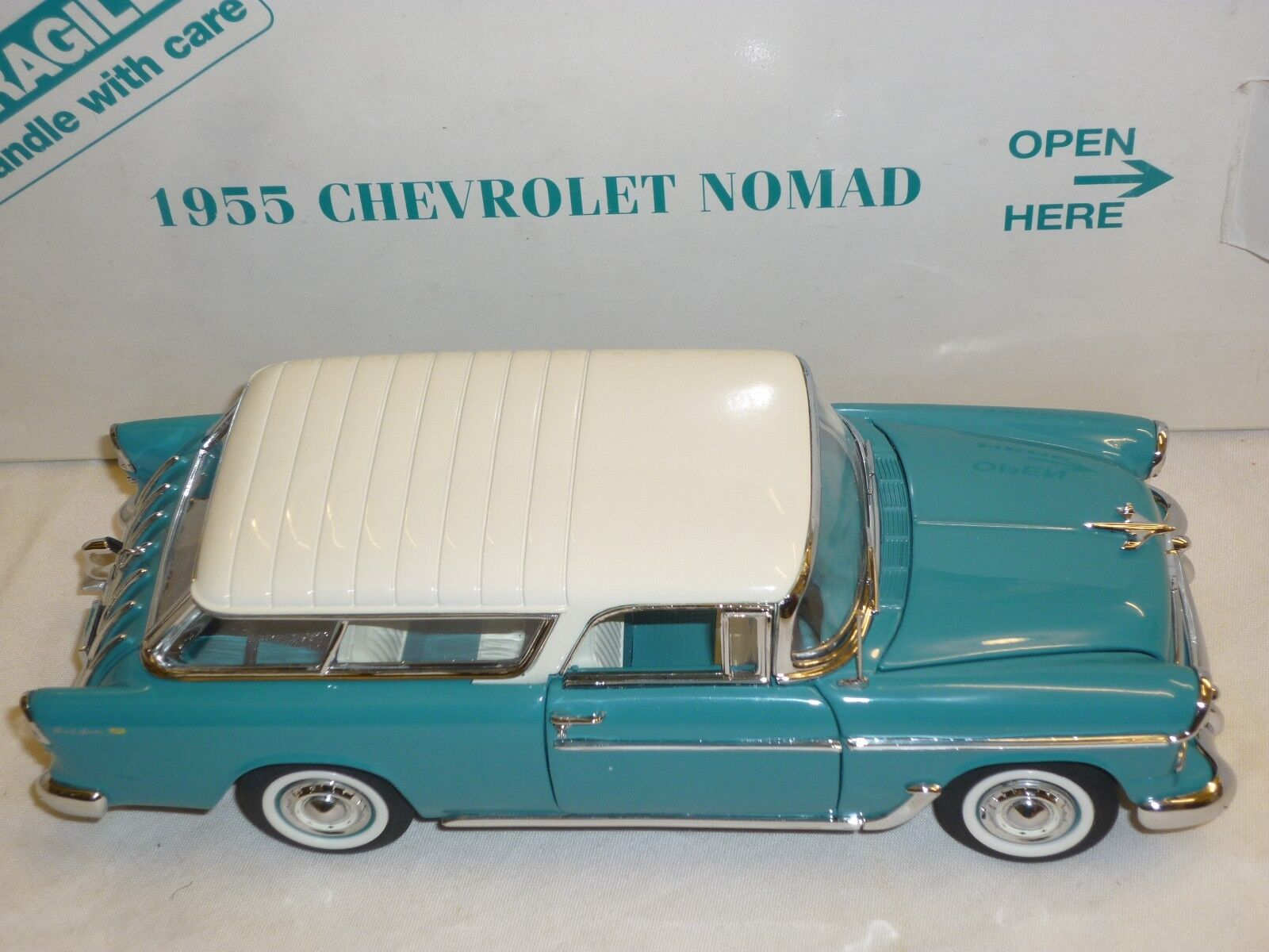 A Danbury mint scale model of a 1955 Chevrolet Normad,  boxed