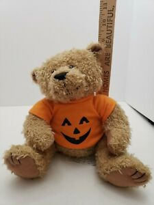 Light-Brown-Sitting-Teddy-Bear-with-Orange-Pumpkin-Face-Halloween-Plush-Cute