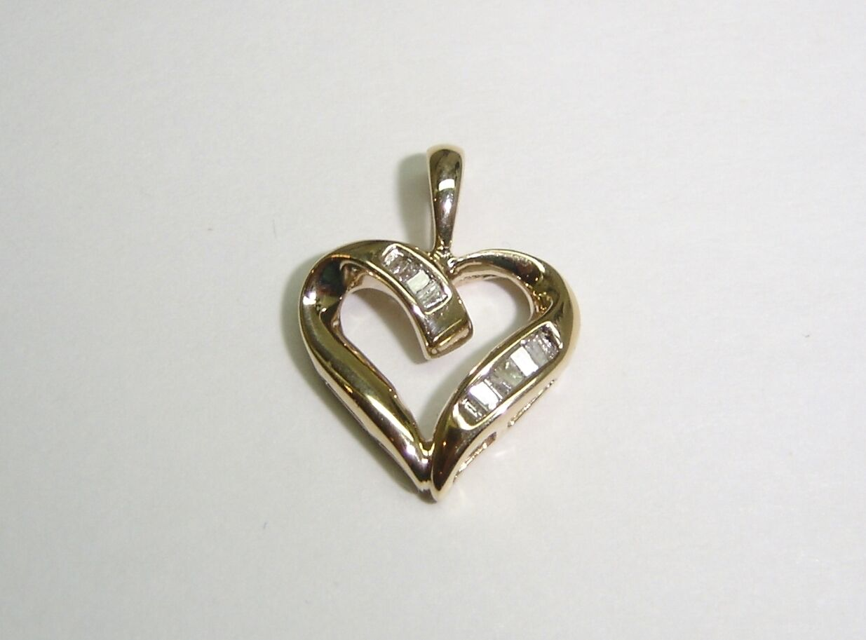 HEART PENDANT WITH BAGUETTE CUT DIAMONDS SET IN 10K YELLOW gold N506-I