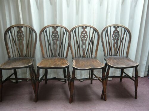 4 Wheelback solid wooden chairs- use or paint