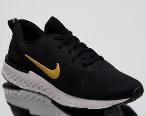 Nike Odyssey Reagieren Damen Laufen Schuhe Schwarz Metallic Gold ...