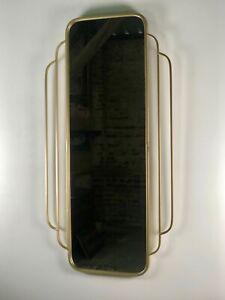 Glace / miroir «Palm Beach» de style Art déco en métal doré Ht 100 cm
