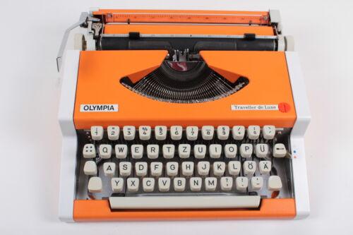 Vintage portable working typewriter ORANGE OLYMPIA TRAVELLER
