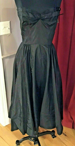 1950s black fit and flare embroidered taffeta cocktail dress with red piping