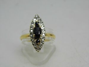 c047a3460ae bague marquise en or jaune et blanc 18k avec saphir et diamant