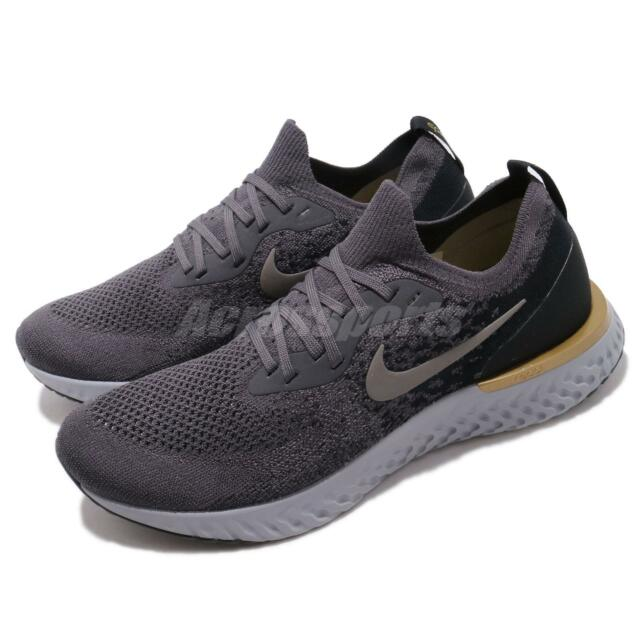 e429f65bc459 Nike Epic React Flyknit Running Shoe Thunder Size 9 Grey gold black ...