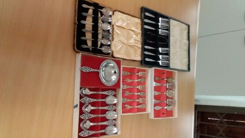 Antique teaspoons and cake forks