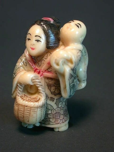 Japanese ivory colored bone  netsuke -Mother Geisha & Her kid,rattan basket
