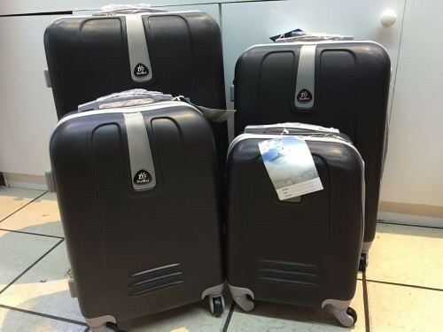 Brand New Set of 4 Suitcases Travel Trolley Luggage,ABS with Universal Wheels (Black)