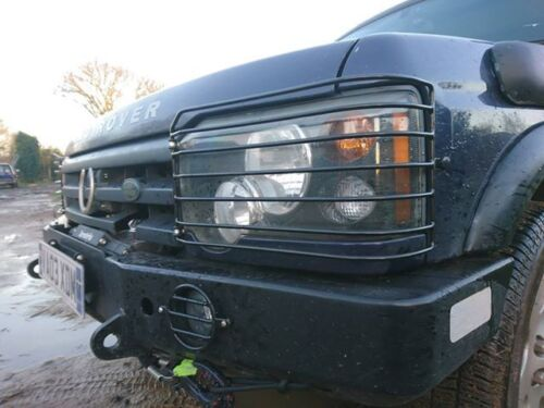 TO L//R  DISCOVERY SERIES II  TD5  FRONT  HEADLIGHT GUARDS   2002 2004