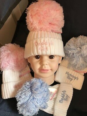 Babies super soft pink and white pom pom hat
