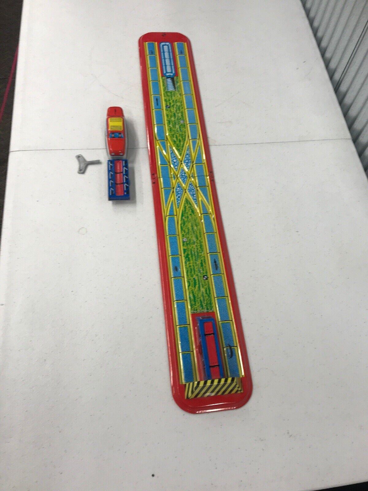 ventas en linea Antiguo    Juguete De De De Estaño Wind Up   Tren Pista de volcado de interruptor  moda clasica