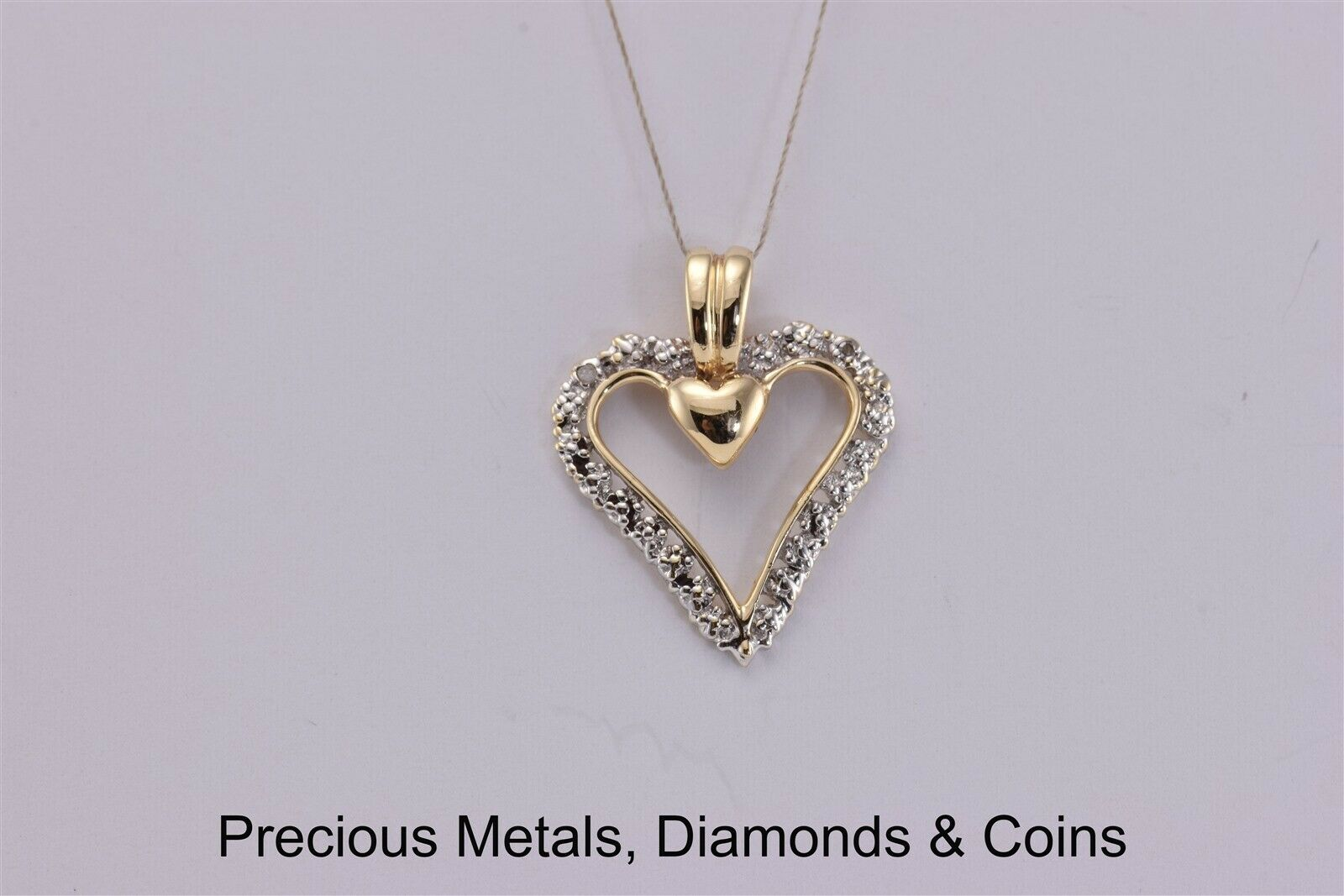 10k Yellow gold 23mm x 18mm Diamond Accented Polished Hearts Pendant