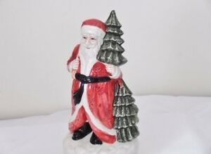 """Santa Claus  Musical Figurine .....Plays """" We wish you a Merry Christmas""""..."""