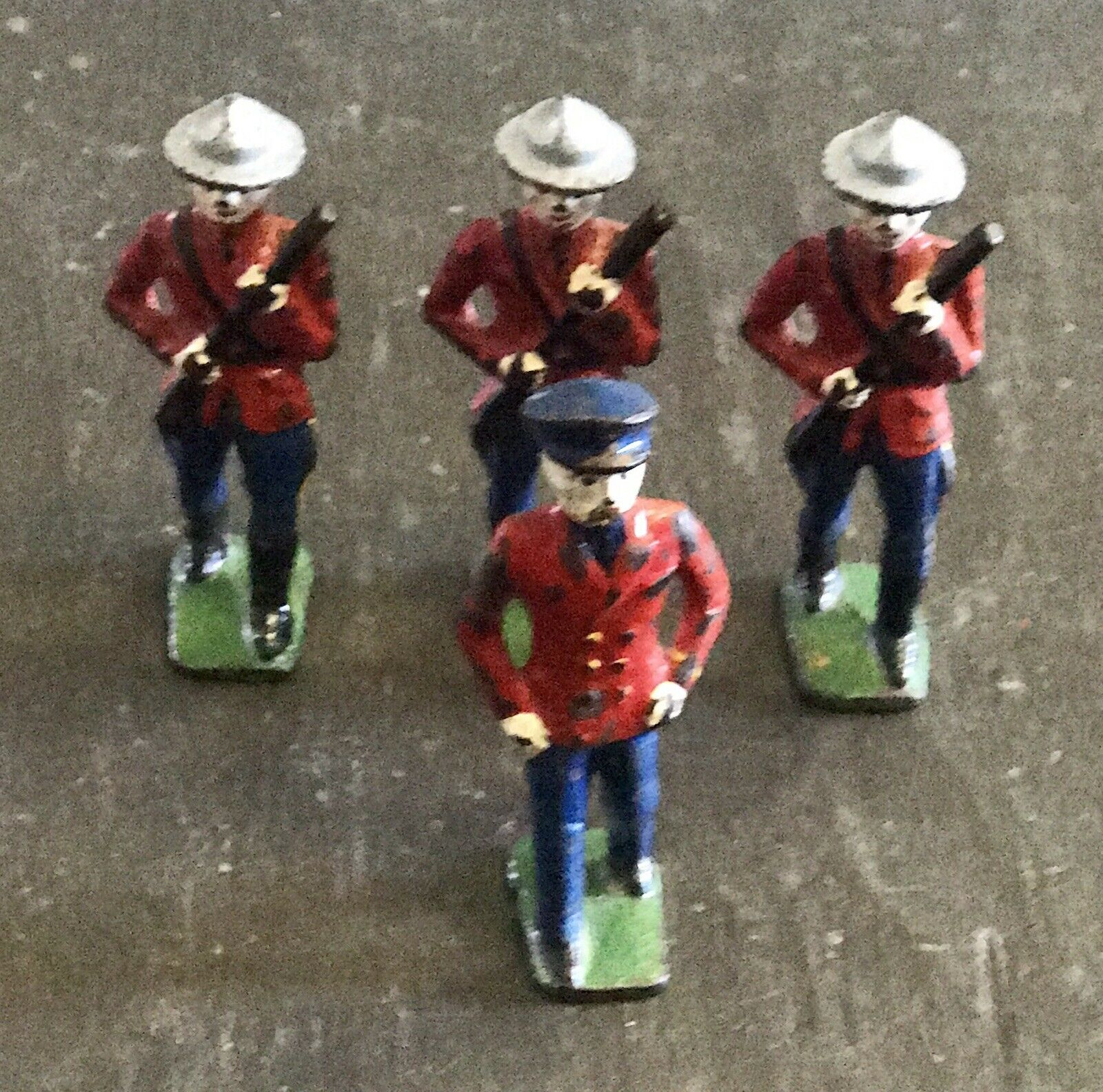 Antique Cast Iron Toy Soldiers.... Mounties 1940's .... Set of 4