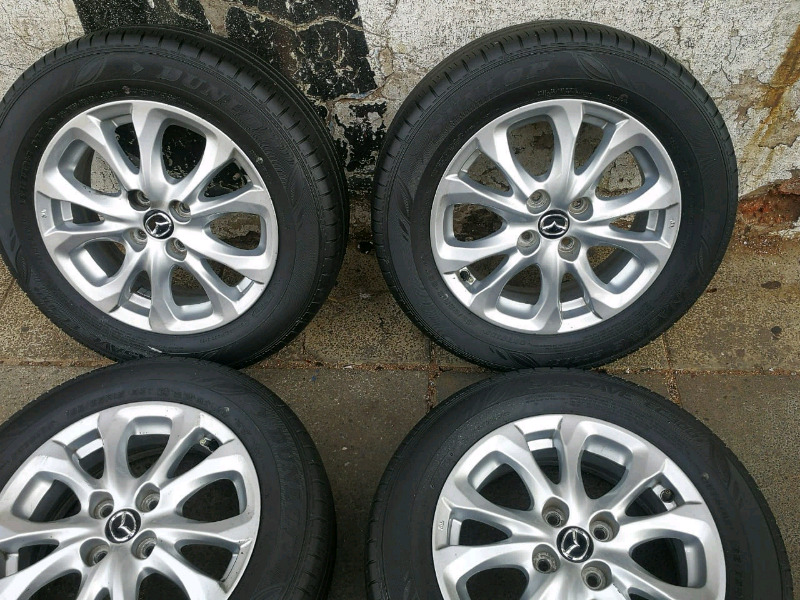 A set of 15 inch mags and tyres for mazda 2