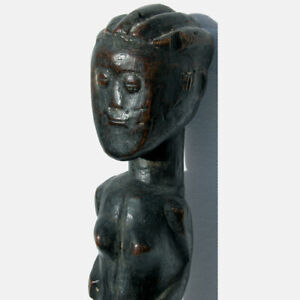 an old antique female african figure lagoon region ghana
