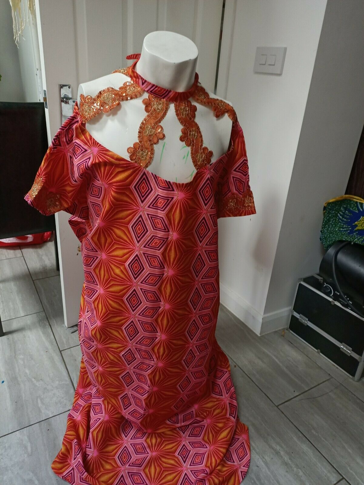 Ladies dress in African print material free size to fit chest up to 54Rins