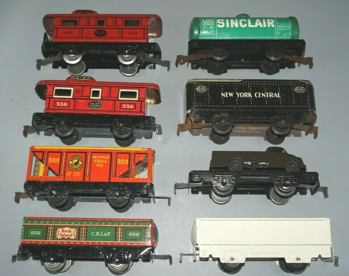 8 MARX PREWAR FREIGHT CARS AND 551, 552, 554, 556, 694, 19844, FLAT CAR, GONDOLA