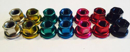 Track nuts in pairs for fixed wheel various colours
