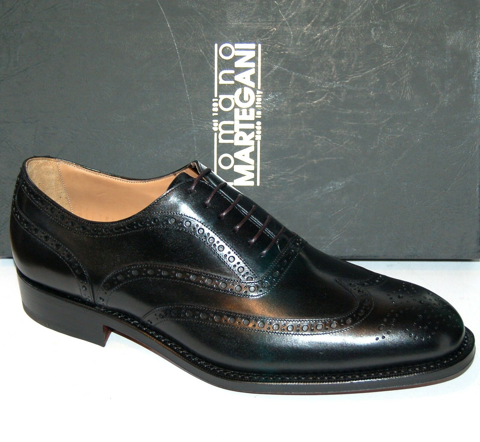 MAN - OXFORD WINGTIP - BLACK CALF W/ PERFS AND MEDALLION - LEATHER SOLE - BLAKE
