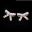 3Ct Baguette Cut Diamond Knot Design Stud Earrings Women 14K White Gold Finish