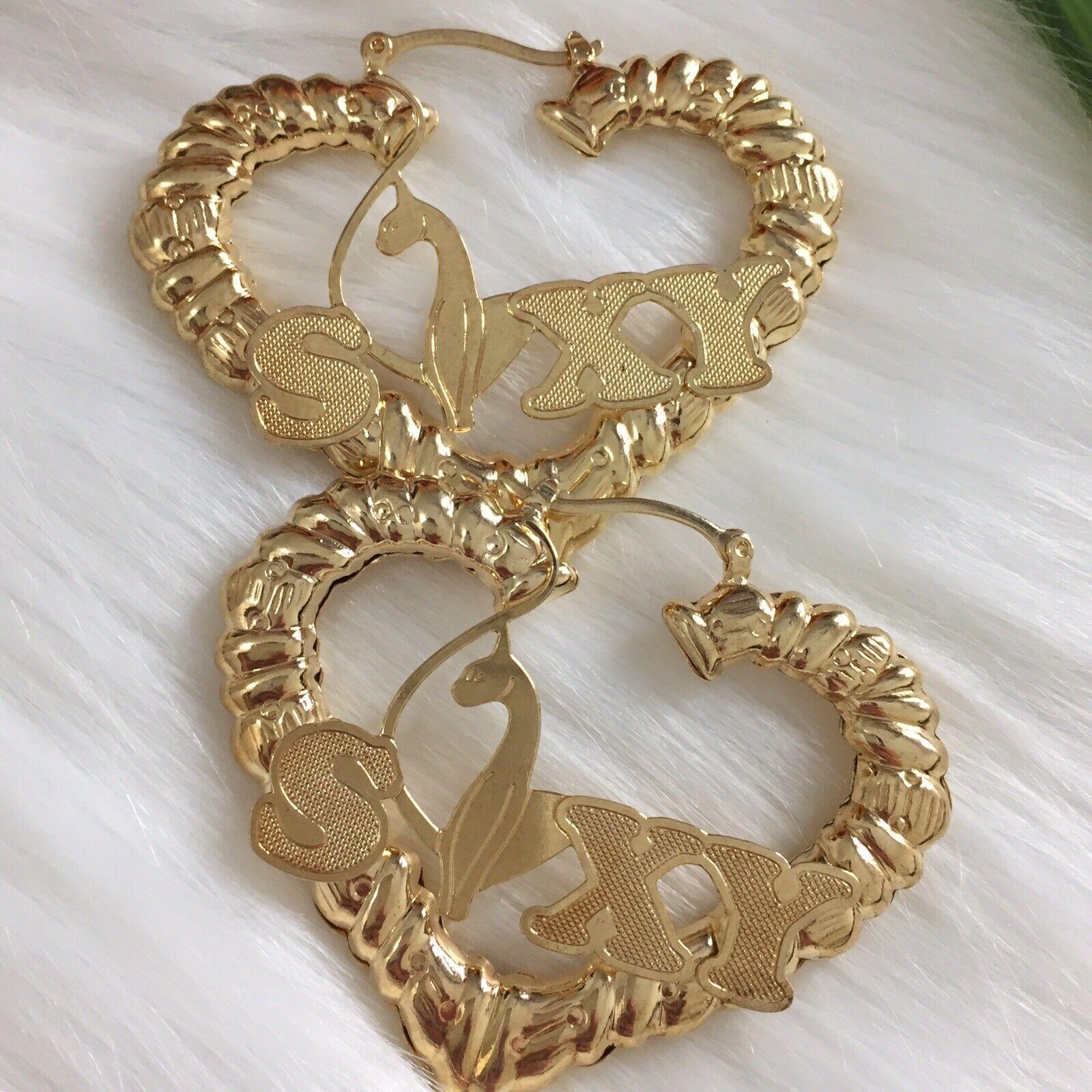 - Heart Bamboo Design Hoop Earrings In 14K Gold Filled. Nameplate