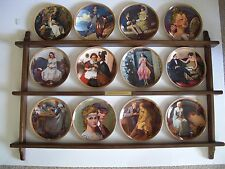 "Rockwell's ""Rediscovered Women"" collector plate set with hanging plate rack"