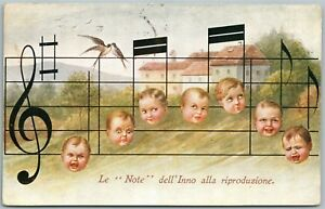 MULTIPLE-BABIES-MUSIC-NOTES-ITALIAN-ANTIQUE-POSTCARD-w-STAMPS