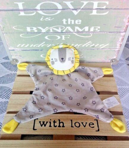 cadeau Doudou plat lion gris jaune blanc étoiles grelot Zeeman