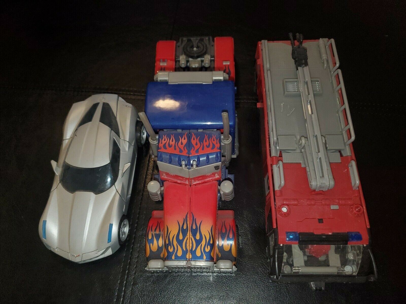Transformers  leader class Optimus prime  and sentinel prime lot of 3