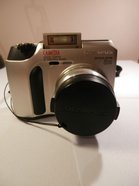 Olympus CAMEDIA 720 Ultra Zoom 3.0 MP Digital Camera - Metallic silver