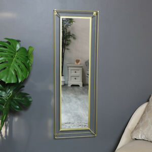 Tall-slim-gold-metal-framed-wall-mounted-mirror-vintage-chic-luxe-home-decor