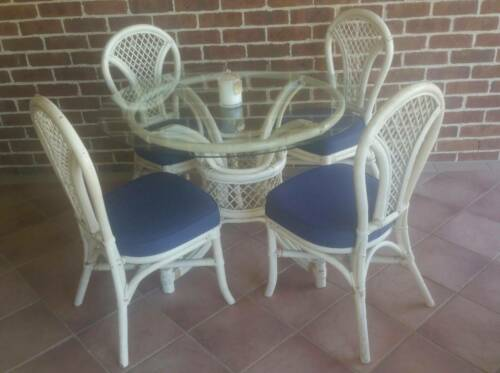 Cane round glass top dining table chairs setting cream off white in outdoor